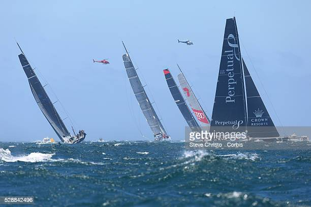 Perpetual Loyal tacks behind Comanche Wild Oats XI Ragamuffin and Black Jack in the Rolex Sydney Hobart outside the Sydney Heads Sydney Australia...