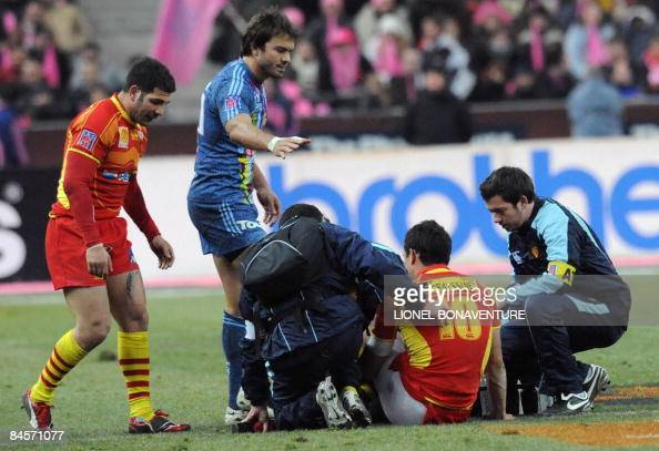 Perpignan's flyhalf Dan Carter sits on the ground after being injured during the French Top14 rugby union match at the Stade de France stadium on...