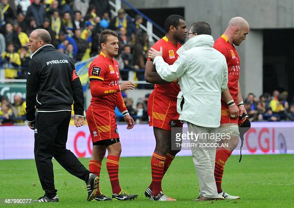 Perpignan's President Francois Riviere comforts his players at the end of the French Rugby Union match ASM Clermont vs USAP Perpignan at the Michelin...