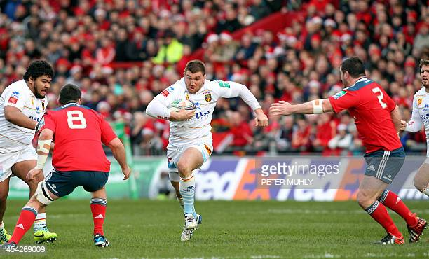 Perpignan's Romain Terrain evades a tackle from Munster's Damien Varley and James Coughlan during the European Cup rugby union match between Munster...