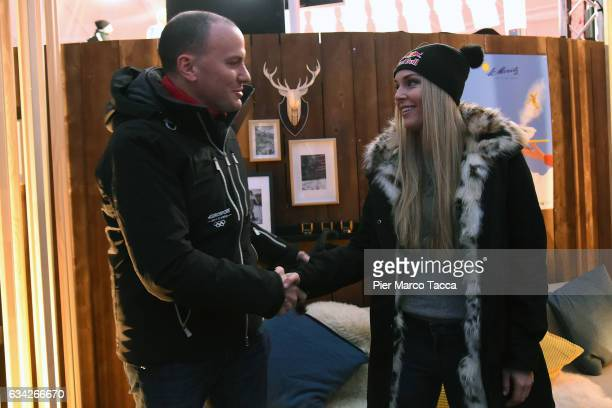 JB Perrette President and CEO Discovery Networks International is shaking hands with Lindsey Vonn during the Lindsey Vonn visits the Eurosport studio...