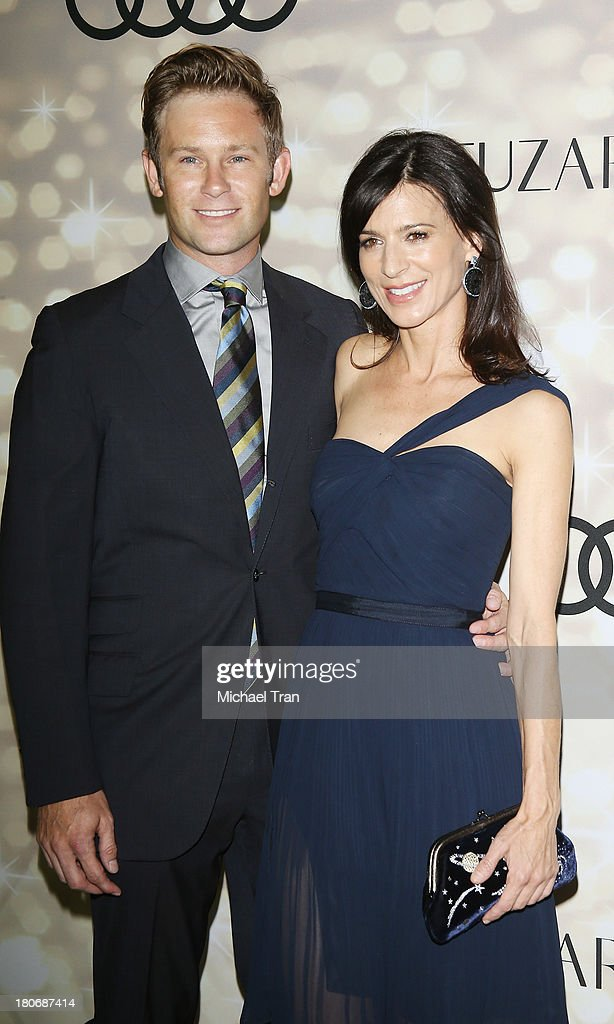 Perrey Reeves (R) and guest arrive at the Audi and Altuzarra EMMYs week 2013 kick-off party held at Cecconi's Restaurant on September 15, 2013 in Los Angeles, California.