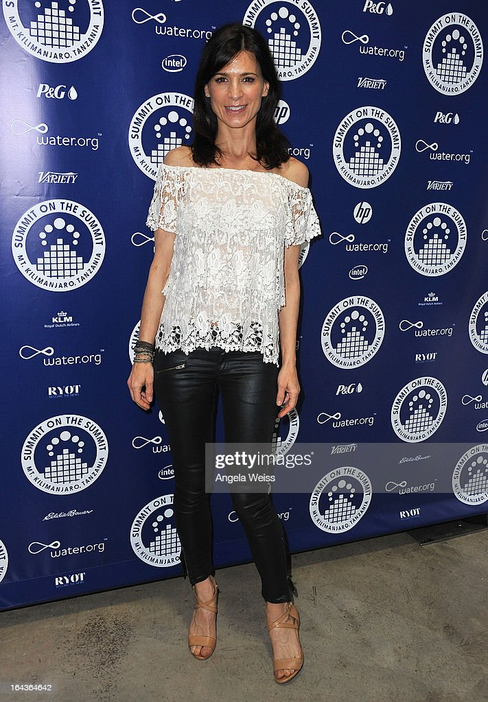 Perrey Reeves arrives at the Summit On The Summit photo exhibition celebrating World Water Day at Siren Studios on March 22, 2013 in Hollywood, California.