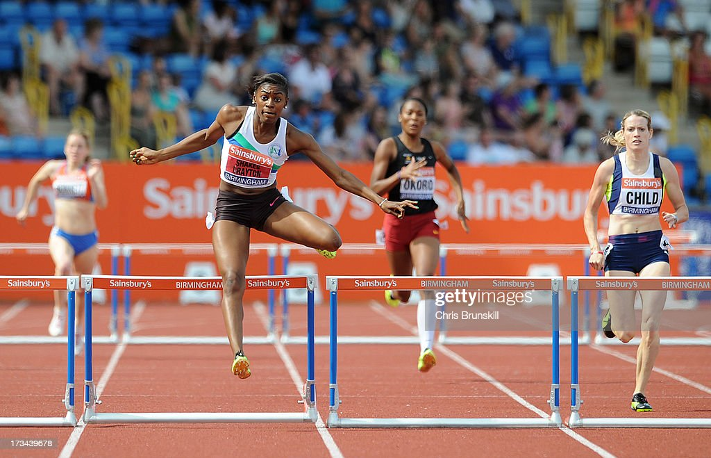 Perri Shakes-Drayton (L) competes in the 400m hurdles final during day three of the Sainsbury's British Championships, British Athletics World Trials and UK & England Championships at Alexander Palace on July 14, 2013 in Birmingham, England.