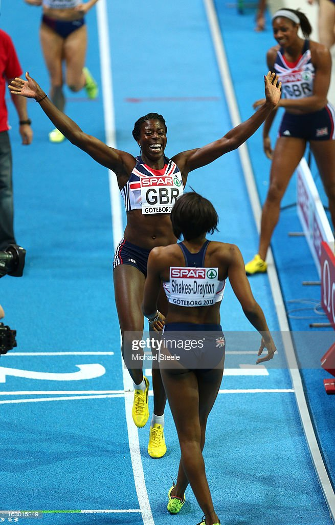 Perri Shakes-Drayton of Great Britain turns to celebrate with Christine Ohuruogu of Great Britain and Northern Ireland after winning gold in the Women's 4x400m Relay Final during day three of European Indoor Athletics at Scandinavium on March 3, 2013 in Gothenburg, Sweden.