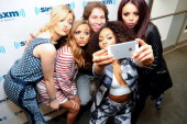 Perrie Edwards Jade Thirlwall Leigh Anne Pinnock and Jessica Nelson of Little Mix visits at SiriusXM Studios on February 6 2014 in New York City