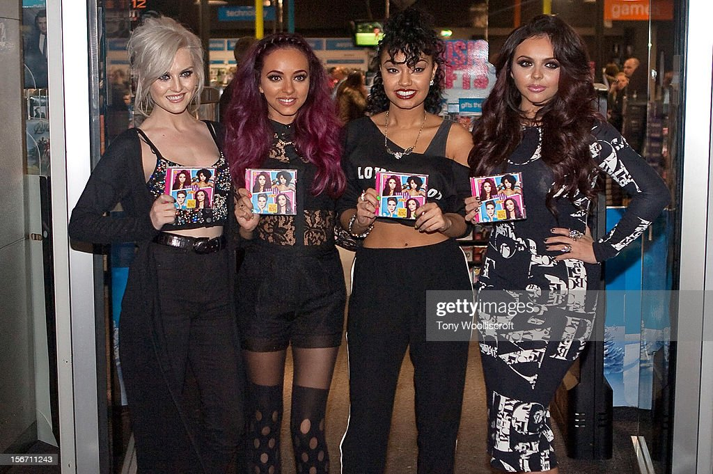 Perrie Edwards, Jade Thirlwall, Leigh-Anne Pinnock and Jesy Nelson of Little Mix meet fans and sign copies of their album 'DNA' on November 19, 2012 in Birmingham, England.