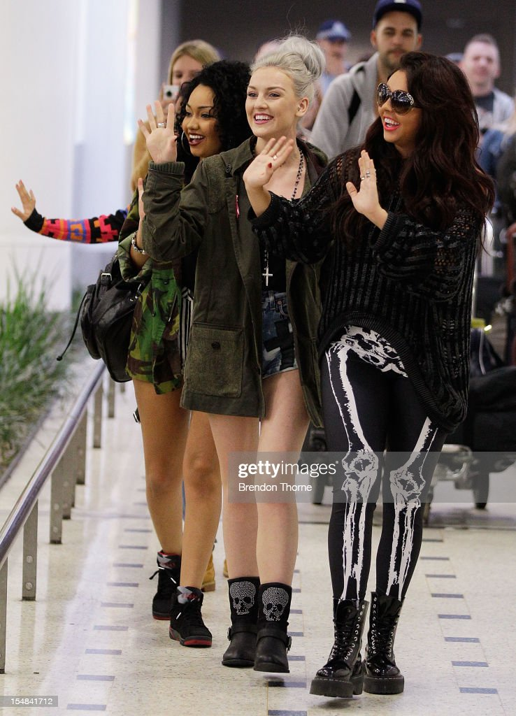 Perrie Edwards Jesy Nelson and LeighAnne Pinnock of the group Little Mix arrive at Sydney International Airport on October 28 2012 in Sydney Australia
