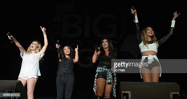 Perrie Edwards Leigh Anne Pinnock Jesy Nelson and Jade Thirlwall of Little Mix perform on stage for the Girlguiding Big Gig 2014 at Wembley Arena on...