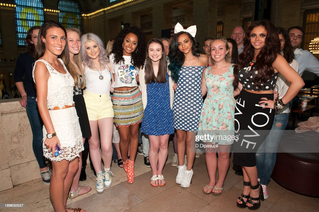 <a gi-track='captionPersonalityLinkClicked' href=/galleries/search?phrase=Perrie+Edwards&family=editorial&specificpeople=8378323 ng-click='$event.stopPropagation()'>Perrie Edwards</a> (3rd L), <a gi-track='captionPersonalityLinkClicked' href=/galleries/search?phrase=Leigh-Anne+Pinnock&family=editorial&specificpeople=8378207 ng-click='$event.stopPropagation()'>Leigh-Anne Pinnock</a> (4th L), <a gi-track='captionPersonalityLinkClicked' href=/galleries/search?phrase=Jade+Thirlwall&family=editorial&specificpeople=8378191 ng-click='$event.stopPropagation()'>Jade Thirlwall</a> (3rd R), and <a gi-track='captionPersonalityLinkClicked' href=/galleries/search?phrase=Jesy+Nelson+-+Little+Mix&family=editorial&specificpeople=8378192 ng-click='$event.stopPropagation()'>Jesy Nelson</a> (R) of Little Mix pose with fans during a visit to 'Extra' at Michael Jordan's The Steak House N.Y.C. in Grand Central Terminal on May 29, 2013 in New York City.