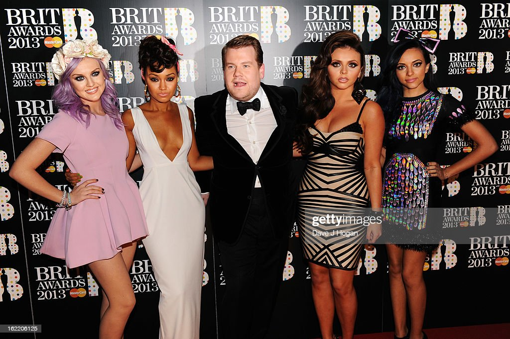 Perrie Edwards, Leigh-Anne Pinnock, James Corden, Jesy Nelson and Jade Thirlwall of Little Mix attend The Brit Awards 2013 at The O2 Arena on February 20, 2013 in London, England.