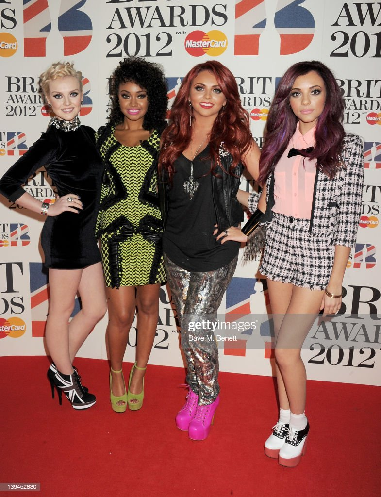 Perrie Edwards LeighAnne Pinnock Jesy Nelson and Jade Thirwell of Little Mix arrive at the BRIT Awards 2012 at O2 Arena on February 21 2012 in London...