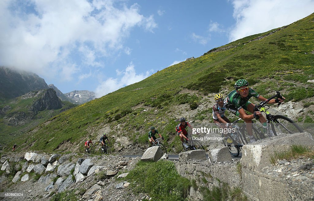 Perrig Quemeneur (R) of France and Team Europcar leads riders on the descent of the Col du Tourmalet during the eighteenth stage of the 2014 Tour de France, a 146km stage between Pau and Hautacam, on July 24, 2014 in La Mongie, France.