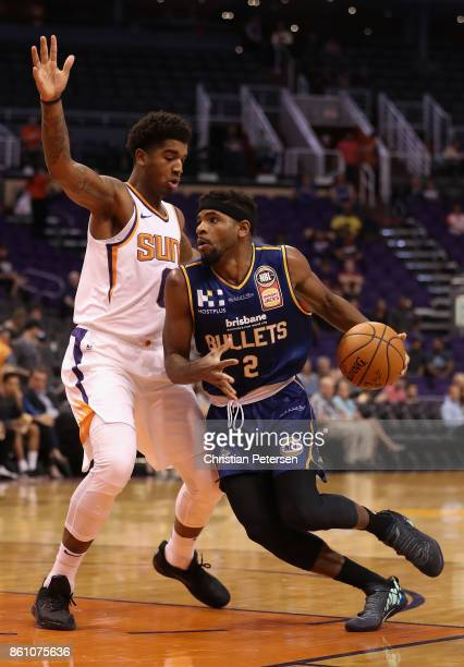 Perrin Buford of the Brisbane Bullets handles the ball against Marquese Chriss of the Phoenix Suns during the first half of the NBA preseason game at...