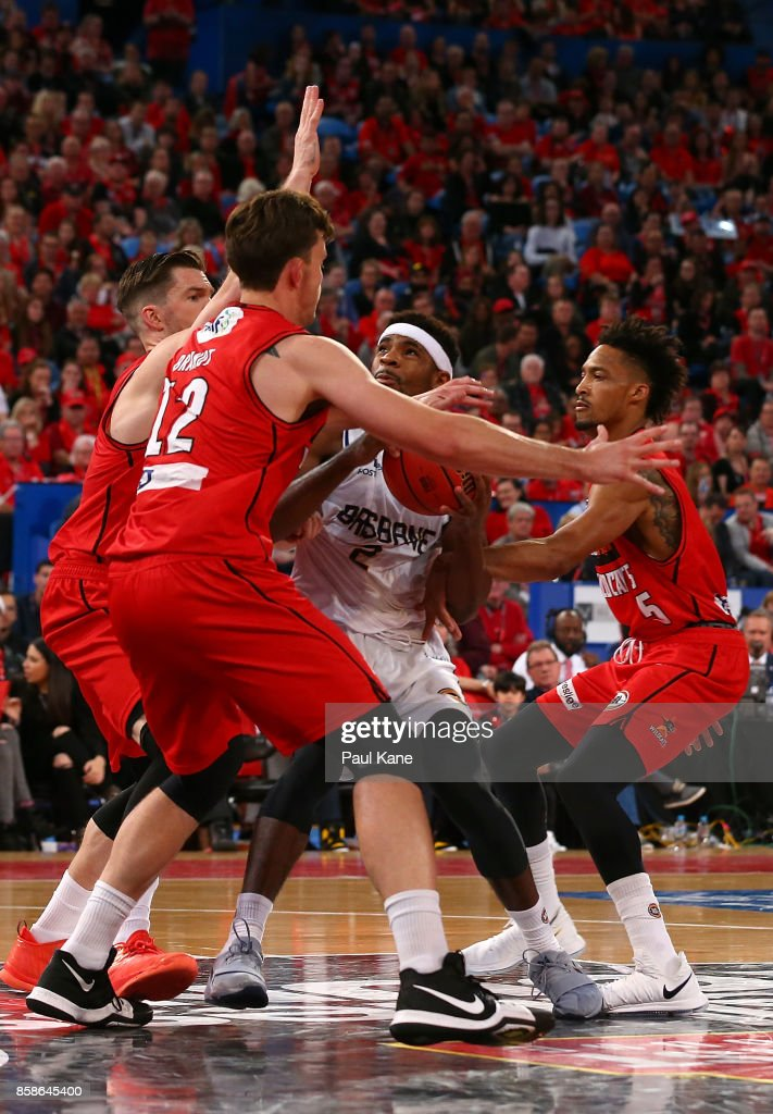 Perrin Buford of the Bullets works to the basket against Lucas Walker, Angus Brandt and Jean-Pierre Tokoto of the Wildcats during the round one NBL match between the Perth Wildcats and the Brisbane Bullets at Perth Arena on October 7, 2017 in Perth, Australia.