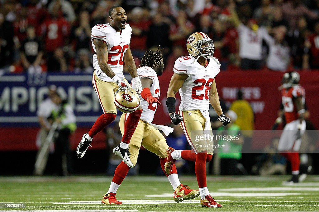 Perrish Cox #20, Anthony Dixon #24 and Darcel McBath #28 of the San Francisco 49ers react after stopping the Atlanta Falcons on fourth down in the fourth quarter in the NFC Championship game at the Georgia Dome on January 20, 2013 in Atlanta, Georgia.
