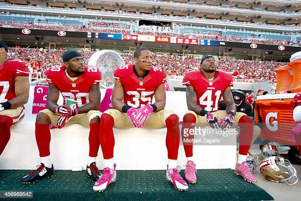 Perrish Cox Eric Reid and Antoine Bethea of the San Francisco 49ers sit on the bench during the game against the Kansas City Chiefs at Levi Stadium...