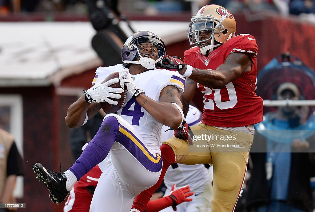 Perrish Cox #20 of the San Francisco 49ers gets called for a face mask penalty on Joe Webb #14 of the Minnesota Vikings after Webb caught a three yard touchdown pass in the third quarter at Candlestick Park on August 25, 2013 in San Francisco, California. The 49ers won the game 34-14.