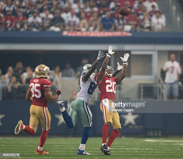 Perrish Cox of the San Francisco 49ers intercepts a pass during the game against the Dallas Cowboys at ATT Stadium on September 7 2014 in Arlington...