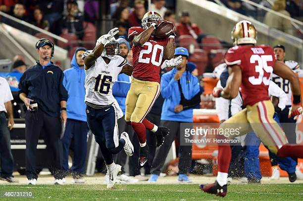 Perrish Cox of the San Francisco 49ers intercepts a pass intended for Seyi Ajirotutu of the San Diego Chargers in the first quarter at Levi's Stadium...