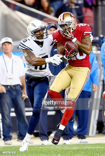 Perrish Cox of the San Francisco 49ers intercepts a pass intended for Seyi Ajirotutu of the San Diego Chargers at Levi's Stadium on December 20 2014...