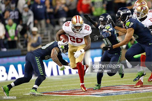 Perrish Cox of the San Francisco 49ers returns a kickoff during the game against the Seattle Seahawks at CenturyLink Field on September 15 2013 in...
