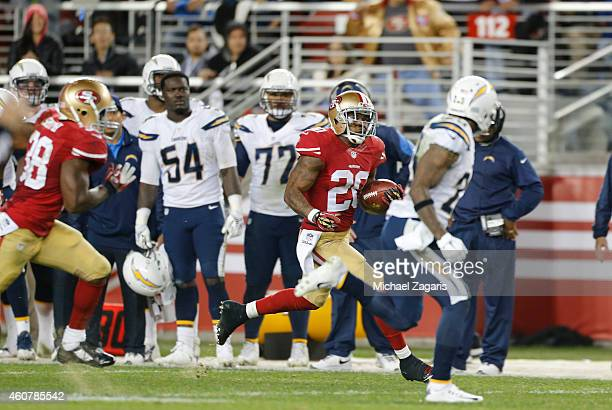 Perrish Cox of the San Francisco 49ers returns a kickoff during the game against the San Diego Chargers at Levi Stadium on December 20 2014 in Santa...