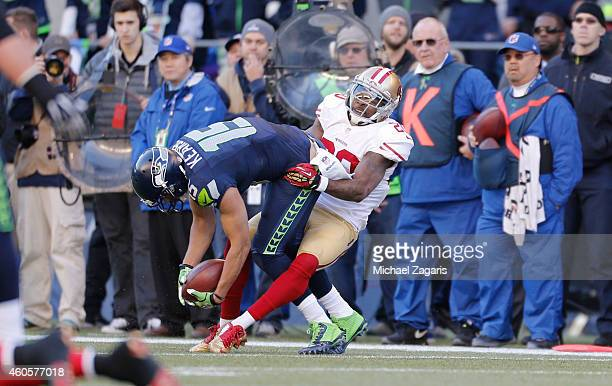 Perrish Cox of the San Francisco 49ers tackles Jermaine Kearse of the Seattle Seahawks during the game at CenturyLink Field on December 14 2014 in...