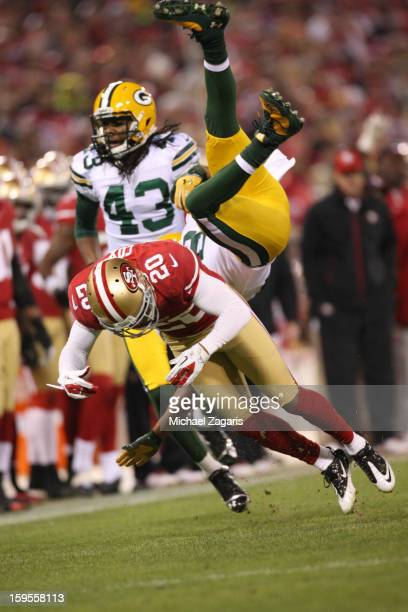 Perrish Cox of the San Francisco 49ers upends Randall Cobb of the Green Bay Packers during the game at Candlestick Park on January 12 2012 in San...