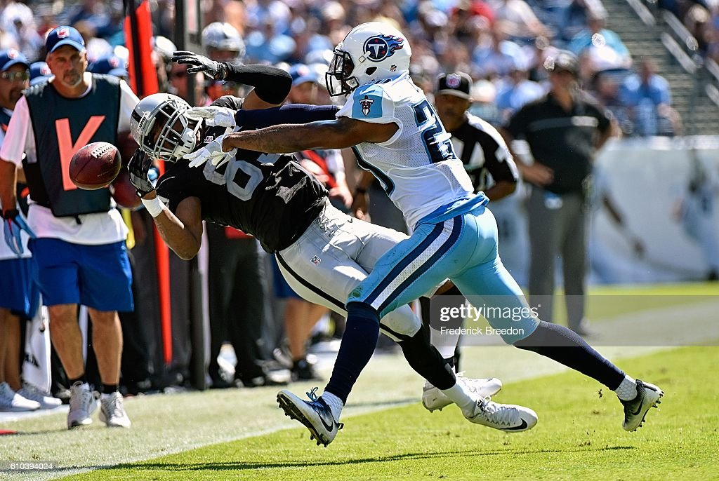 Perrish Cox #20 of the Tennessee Titans pushes Amari Cooper #89 of the Oakland Raiders out of bounds causing an incompletion during the first half at Nissan Stadium on September 25, 2016 in Nashville, Tennessee.