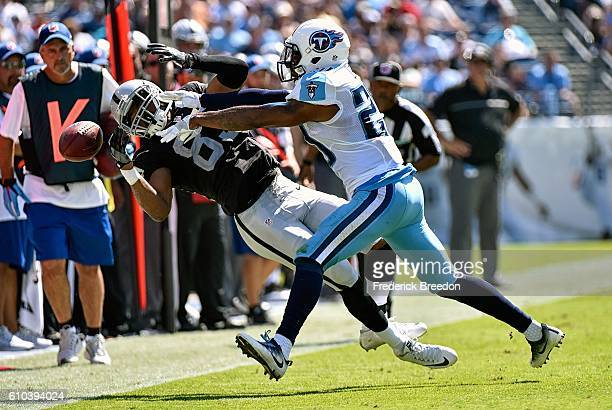 Perrish Cox of the Tennessee Titans pushes Amari Cooper of the Oakland Raiders out of bounds causing an incompletion during the first half at Nissan...