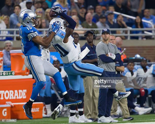 Perrish Cox of the Tennessee Titans reaches for the football in front of Golden Tate of the Detroit Lions during an NFL game at Ford Field on...