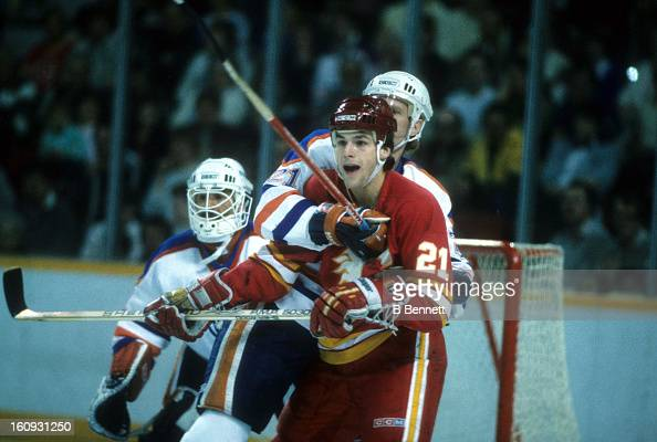 Perry Berezan of the Calgary Flames battles with Randy Gregg of the Edmonton Oilers during the 1986 Division Finals in April 1986 at the Northlands...