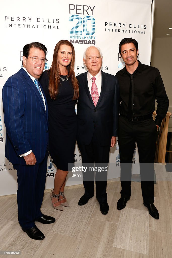 )L-R) Perry Ellis International President and COO Oscar Feldenkreis, <a gi-track='captionPersonalityLinkClicked' href=/galleries/search?phrase=Brooke+Shields&family=editorial&specificpeople=202197 ng-click='$event.stopPropagation()'>Brooke Shields</a>, Perry Ellis International Chairman and CEO George Feldenkreis and <a gi-track='captionPersonalityLinkClicked' href=/galleries/search?phrase=Gilles+Marini&family=editorial&specificpeople=5360860 ng-click='$event.stopPropagation()'>Gilles Marini</a> attend Perry Ellis International celebration of the opening of its new NYC Headquarters at The Hippodrome Building on June 11, 2013 in New York City.
