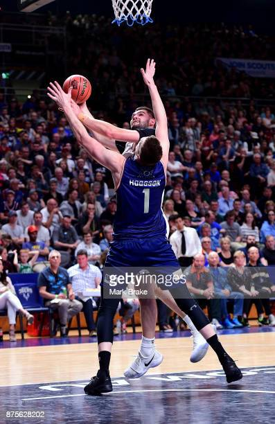 Perry Ellis of Sydney goes for the basket over Matthew Hodgson during the round seven NBL match between Adelaide 36ers and the Sydney Kings at...