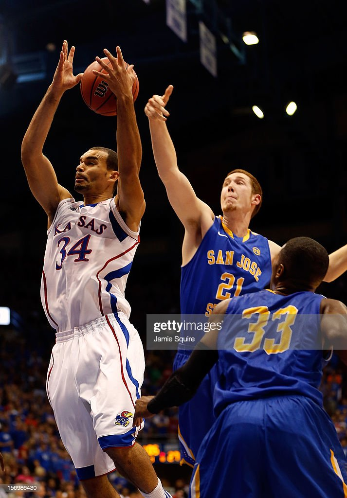 Perry Ellis of the Kansas Jayhawks beats Mike VanKirk and James Kinney of the San Jose State Spartans for a rebound during the game at Allen...