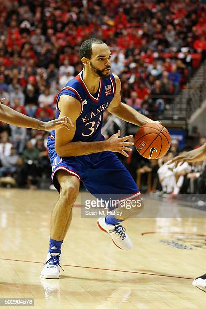 Perry Ellis of the Kansas Jayhawks dribbles the ball during a game against the San Diego State Aztecs at Viejas Arena on December 22 2015 in San...