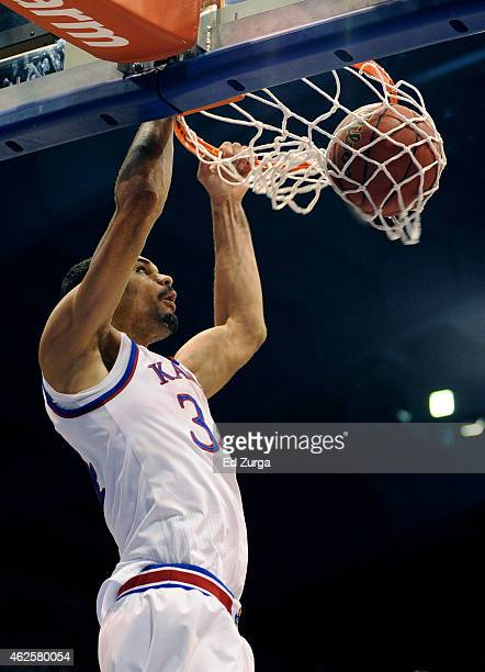 Perry Ellis of the Kansas Jayhawks dunks the ball during a game against the Kansas State Wildcats at Allen Field House in the first half on January...