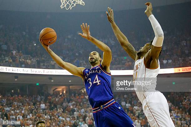 Perry Ellis of the Kansas Jayhawks goes to the basket against Prince Ibeh of the Texas Longhorns at the Frank Erwin Center on February 29 2016 in...