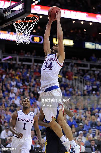Perry Ellis of the Kansas Jayhawks goes up for a dunk against the West Virginia Mountaineers in the second half during the championship game of the...