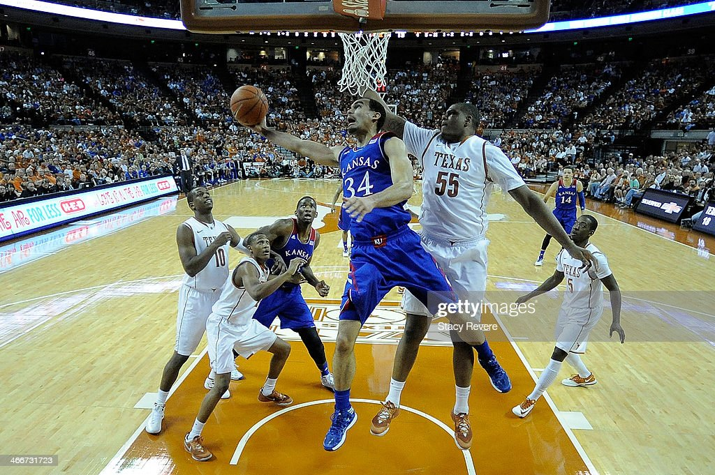 Perry Ellis #34 of the Kansas Jayhawks is defended by <a gi-track='captionPersonalityLinkClicked' href=/galleries/search?phrase=Cameron+Ridley&family=editorial&specificpeople=7887105 ng-click='$event.stopPropagation()'>Cameron Ridley</a> #55 of the Texas Longhorns during a game at The Frank Erwin Center on February 1, 2014 in Austin, Texas. Texas won the game 81-69.