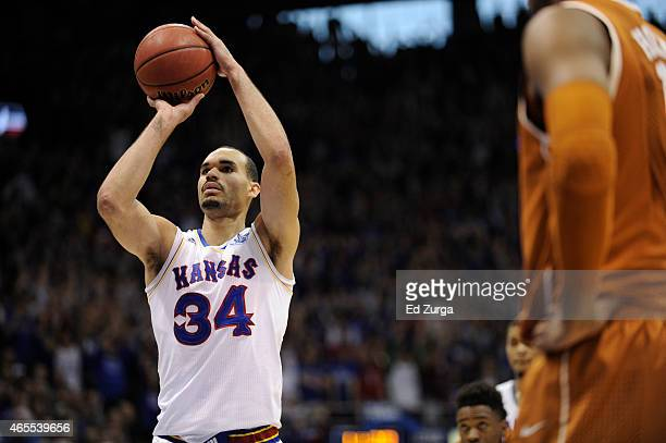 Perry Ellis of the Kansas Jayhawks shoots a free throw against the Texas Longhorns at Allen Fieldhouse on February 28 2015 in Lawrence Kansas Kansas...