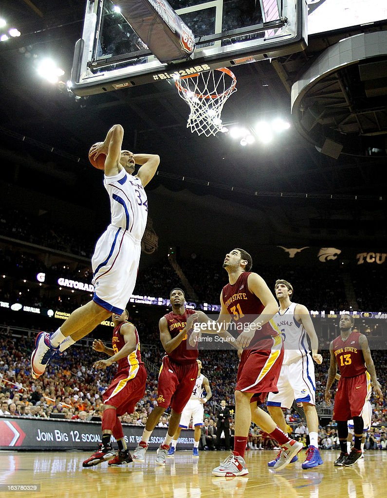 Perry Ellis #34 of the Kansas Jayhawks shoots against Georges Niang #31 of the Iowa State Cyclones in the second half during the Semifinals of the Big 12 basketball tournament at the Sprint Center on March 15, 2013 in Kansas City, Missouri.