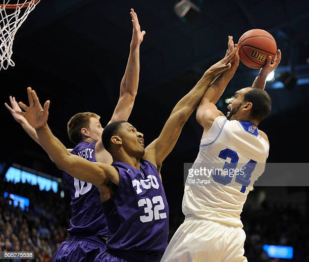 Perry Ellis of the Kansas Jayhawks shoots against Vladimir Brodziansky and Karviar Shepherd of the TCU Horned Frogs in the first half at Allen...