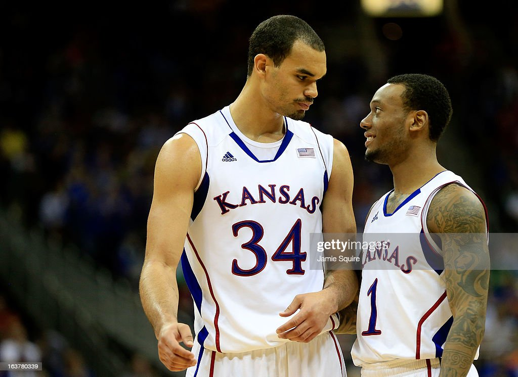 Perry Ellis #34 of the Kansas Jayhawks talks with teammate Naadir Tharpe #1 in the second half against Iowa State Cyclones during the Semifinals of the Big 12 basketball tournament at the Sprint Center on March 15, 2013 in Kansas City, Missouri.