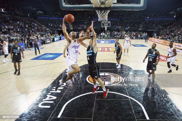 Perry Ellis of the Kings goes to the basket against Kirk Penney of the Breakers during the round three NBL match between the New Zealand Breakers and...