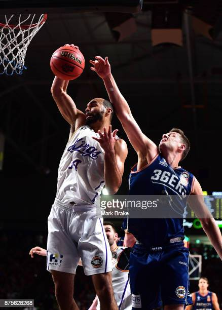 Perry Ellis of the Sydney Kings rebounds in front of Daniel Johnson of the 36ers during the round seven NBL match between Adelaide 36ers and the...