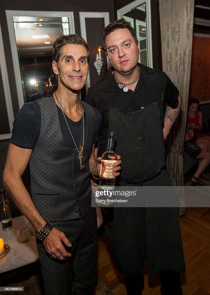 Perry Farrell and Chef Anthony DiRienzo kick off Lollapalooza with Dobel Tequila at Nellcote on July 30 2015 in Chicago Illinois