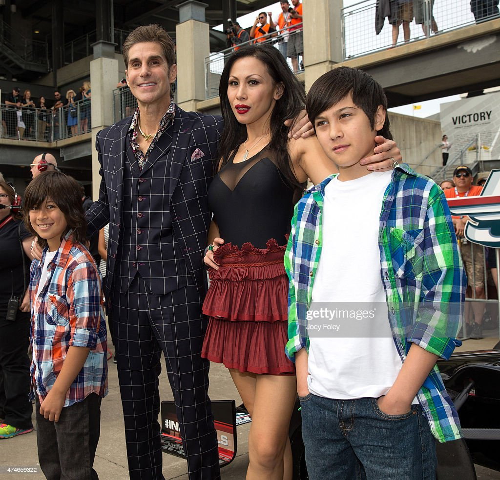Perry Farrell and his wife and family of the Alternative rock band Jane's Addiction attends the 2015 Indy 500 at Indianapolis Motorspeedway on May 24, 2015 in Indianapolis, Indiana.