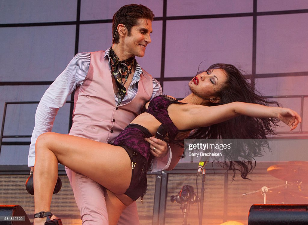 Perry Farrell and his wife Etty Lau Farrell of Jane's Addiction perform during 2016 Lollapalooza Day Three at Grant Park on July 30 2016 in Chicago...